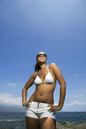Multi ethnic young adult woman standing on beach in bikini. Stock Photo - 2168025