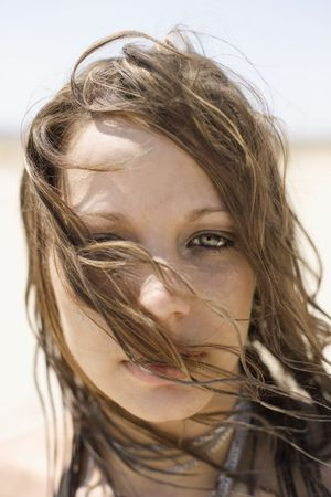 Portrait of Caucasian mid-adult woman with hair blowing across face looking at viewer. Stock Photo - 2168067