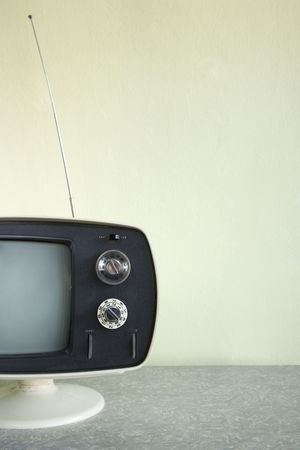 telly: Still life of vintage television set with antenna raised.