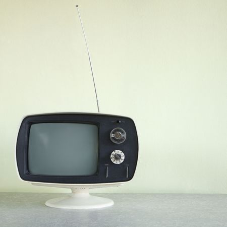retro tv: Still life of vintage television set with antenna raised.