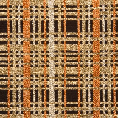 intersecting: Close-up of woven vintage fabric with brown and gold crossbar pattern.