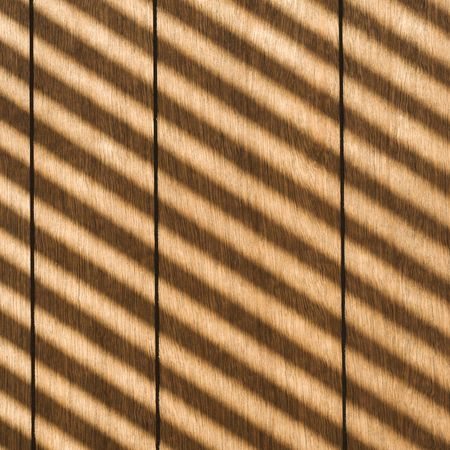 diagonal stripes: Sunlight reflecting diagonal stripes onto wood paneling.