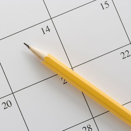 Pencil on top of a blank calendar. Stock Photo