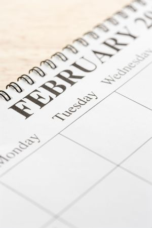 organiser: Close up of spiral bound calendar displaying month of February.
