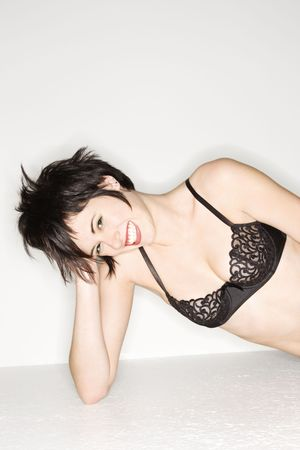 Young sexy Caucasian woman wearing black lace bra and smiling at the viewer. Stock Photo - 2168697