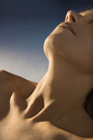 bare shoulders: Neck, chest and face of Caucasian young adult female.