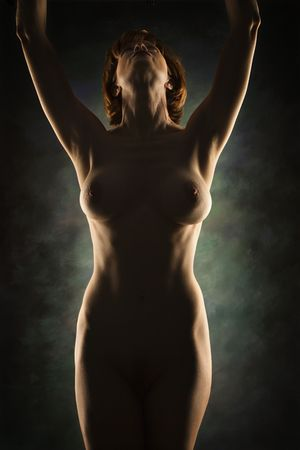 Nude Caucasian woman looking up with arms raised over head. Stock Photo - 2168701