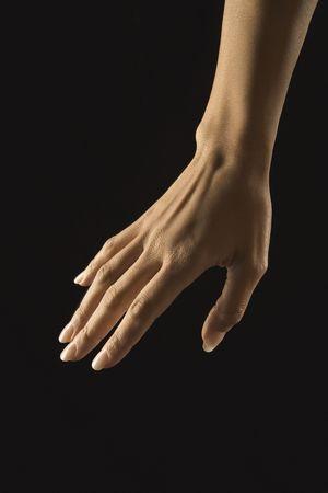 mid adult female: Hispanic mid adult female hand with manicure. Stock Photo