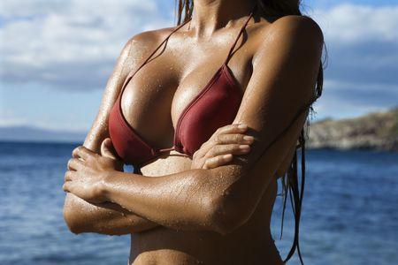 wet breast: Breast shot of young adult Asian Filipino in bikini on beach in Maui Hawaii.