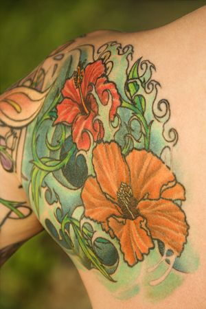 Close up of floral tattoo on shoulder of Caucasian woman.