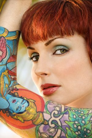 the sleeve: Close up portrait of attractive tattooed Caucasian woman in Maui, Hawaii, USA.
