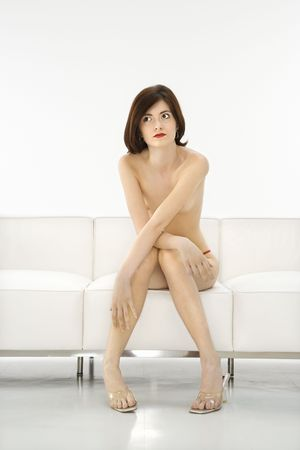 Portrait of partially nude attractive redhead Caucasian young woman.