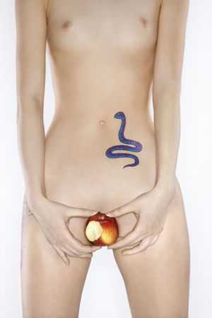 Portrait of nude attractive redhead Caucasian young woman with snake tattoo holding apple. Stock Photo - 2188592