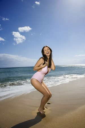 Pretty smiling young Caucasian woman in swimsuit having fun at beach in Maui Hawaii. Stock Photo - 2188663
