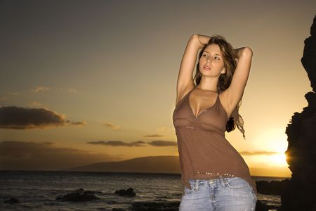 Portrait of sexy young Caucasian woman with arms behind head at scenic rocky coast in Maui Hawaii. Stock Photo - 2188480