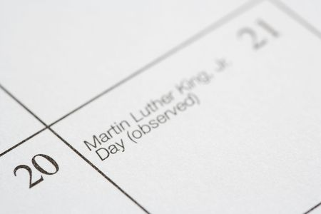 luther: Close up of calendar displaying Martin Luther King Junior Day.