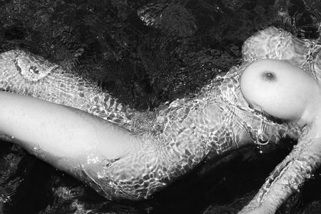 beach breast: Close up torso of young adult nude Caucasian woman in water in Maui.