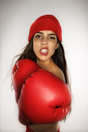 Caucasian woman wearing boxing gloves and hat. photo