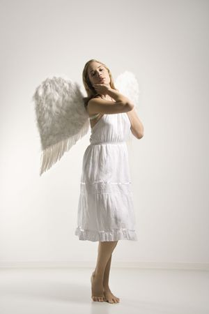 Caucasian mid-adult woman in white angel costume.