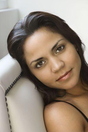 Head shot of Hispanic woman looking at viewer. Stock Photo - 2188110