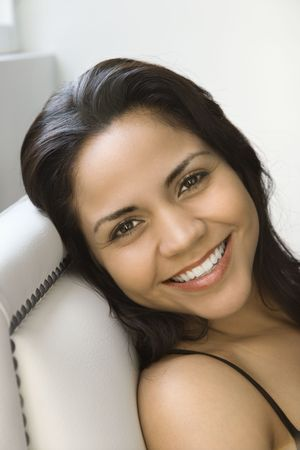 Head shot of smiling Hispanic woman looking at viewer.  Stock Photo - 2188068