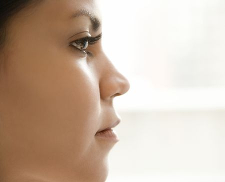 side profiles: Close up profile of Hispanic young adult womans face.