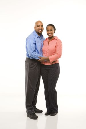 eachother: Portrait of African American couple with arms around eachother against white background.
