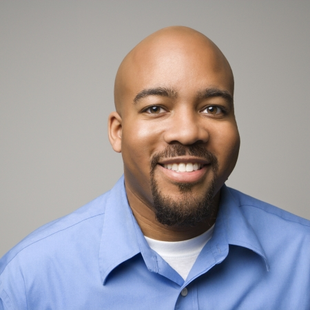 Portrait of African American man smiling against gray background. Stock Photo - 2205511