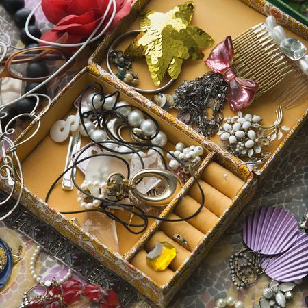 accessorize: Above view of open jewelry box sitting on top of dresser. Stock Photo