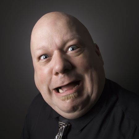 gasp: Caucasian mid adult bald man looking at viewer and making facial expression.