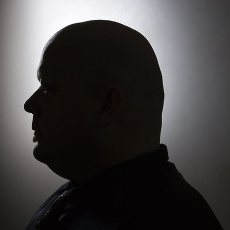 man profile: Caucasian mid adult bald man silhouette.