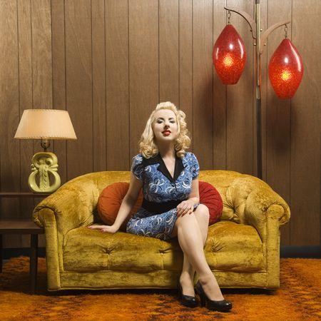 Attractive Caucasian woman sitting in retro decorated room. photo