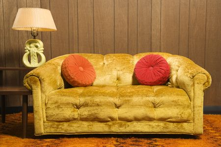 davenport: Still life of retro style room.