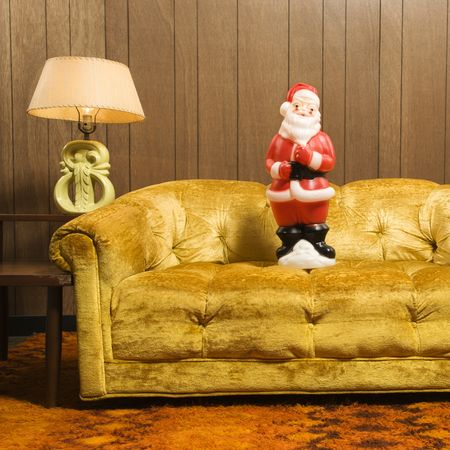 Santa clause figurine on retro style couch. photo