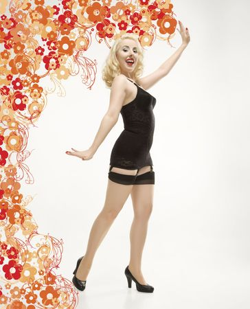 Attractive Caucasian woman wearing retro lingerie in pinup pose with graphic background. photo