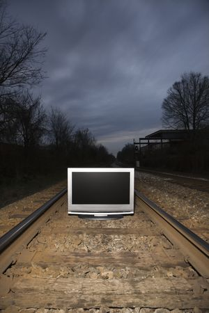 Flat panel television set on railroad tracks at night. Stock Photo - 2205763