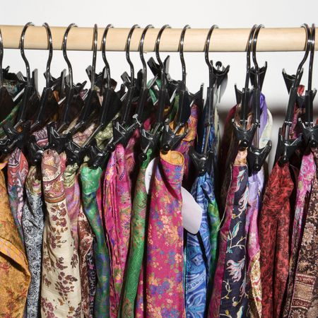 clothes rack: Colorful clothes hanging on rack.