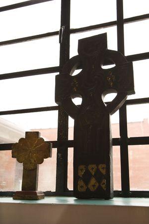 windowsill: Celtic crosses sitting on windowsill.