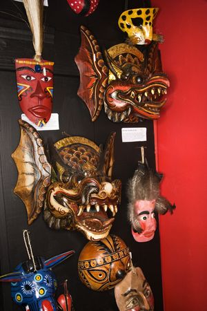 Folk art masks hanging in retail store. photo