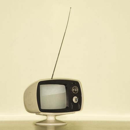 retro tv: Stilll life of vintage television set with antenna raised. Stock Photo