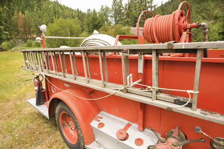 antique fire truck: Close-up of old fire truck and ladder. Stock Photo