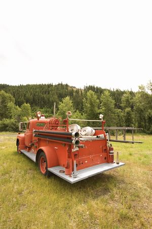antique fire truck: Rear view of old fire truck. Stock Photo