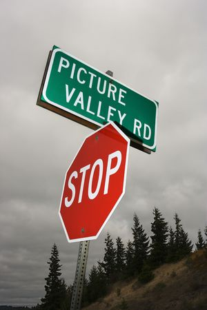 rd: Stop sign and road sign reading Picture Valley Rd. Stock Photo