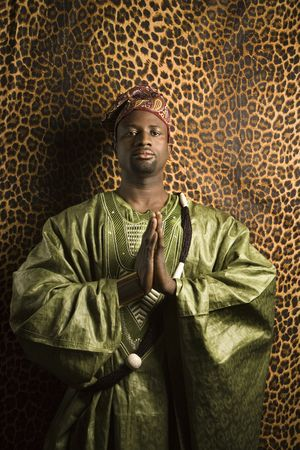 Portrait of African- American mid-adult man in prayer wearing traditional African clothing. Stock Photo - 2219868