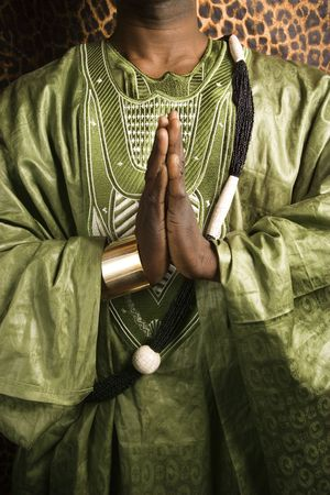 Close-up of African-American mid-adult man wearing traditional African clothing in prayer. Stock Photo - 2219879