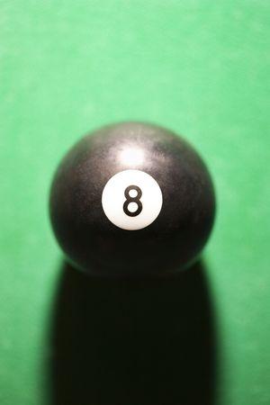 eight ball: Close-up of eight ball on green billiards table. Stock Photo