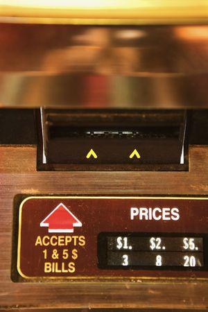jukebox: Close-up of money slot on jukebox.