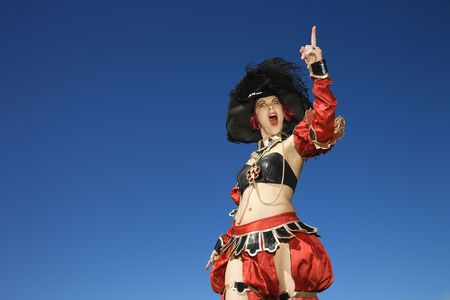 enact: Young adult Caucasian female dressed in pirate costume.