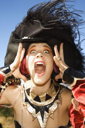 enact: Close up of young adult Caucasian female dressed in pirate costume. Stock Photo