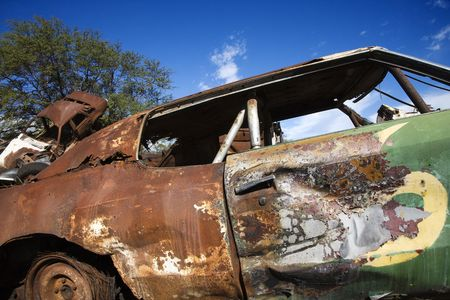abandoned car: Old abandoned and rusted car.